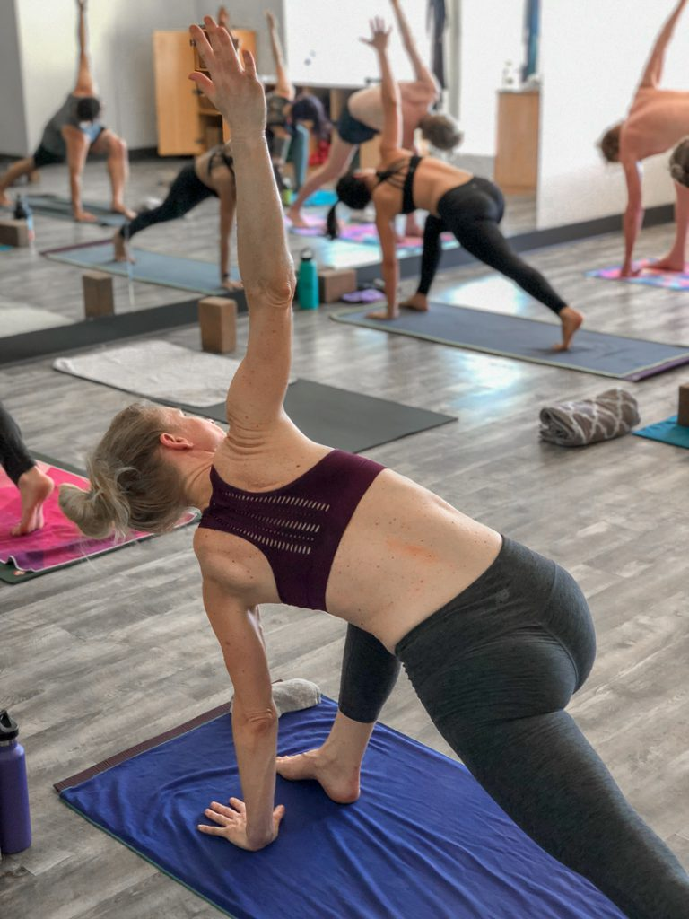 Peace Love & Yoga share the 5 benefits of hot yoga.