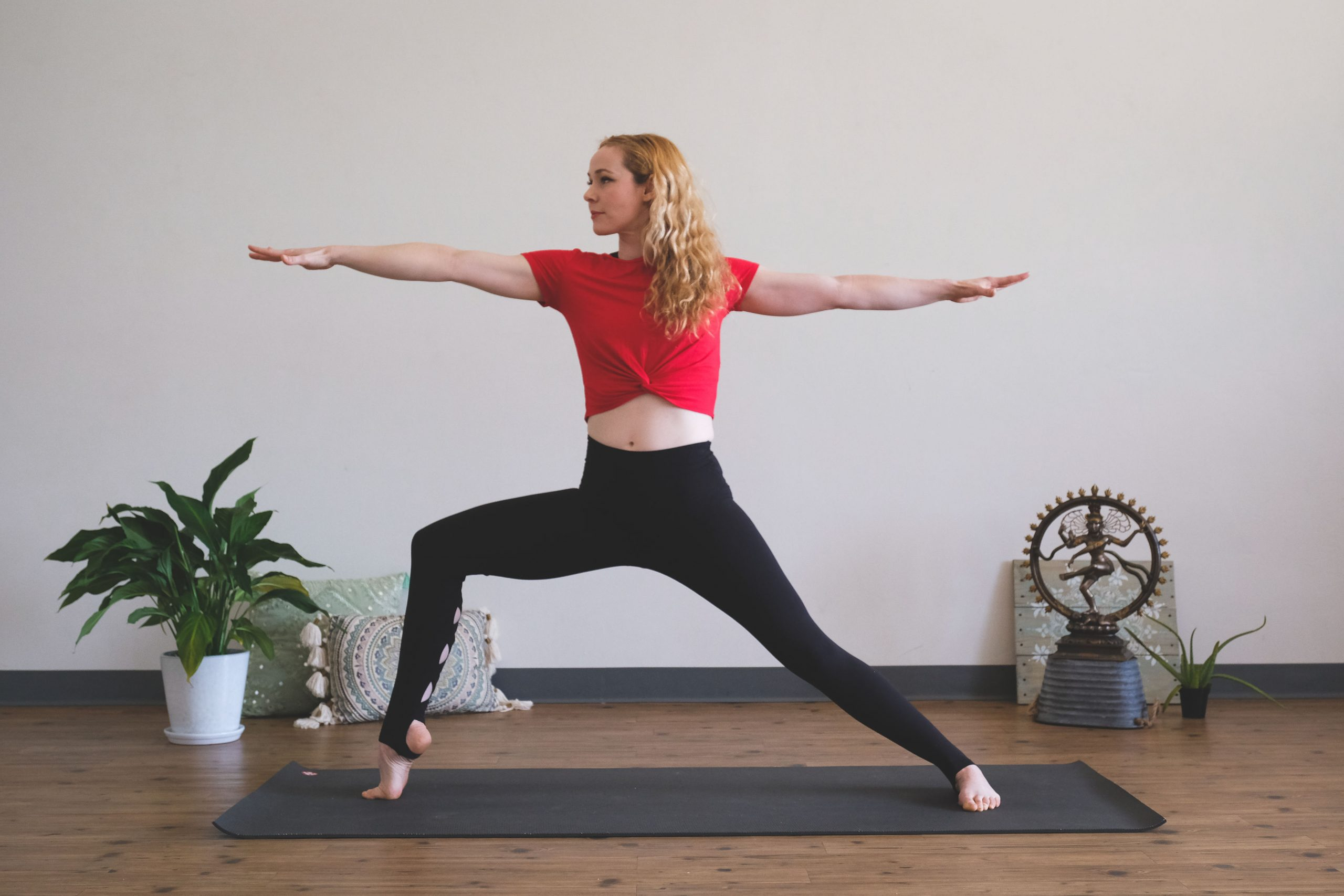 peace love and yoga; woman in warrior pose