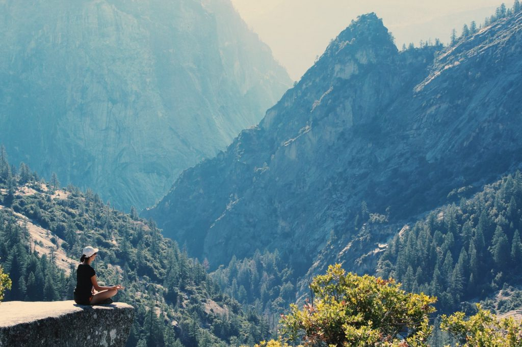 peace love and yoga; woman meditating and traveling
